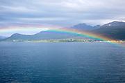Rainbow over sea near Stokmarknes, Hadsel municipality, Hadseloya island, Nordland, Vesteralen region, northern Norway