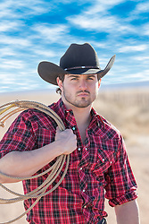 rugged cowboy holding a lasso