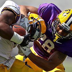 April 9, 2011; Baton Rouge, LA, USA;  LSU Tigers running back Spencer Ware (11) is tackled by defensive back Ronnie Vinson during the 2011 Spring Game at Tiger Stadium.   Mandatory Credit: Derick E. Hingle
