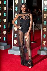 © Licensed to London News Pictures. 18/02/2018. AJ ODUDU arrives on the red carpet for the EE British Academy Film Awards 2018, held at the Royal Albert Hall, London, UK. Photo credit: Ray Tang/LNP