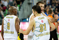 Saso Ozbolt and Goran Jagodnik of Olimpija celebrate after winning the basketball match between KK Union Olimpija (SLO) and Efes Pilsen (Tur) in Group D of Turkish Airlines Euroleague, on October 20, 2010 in SRC Stozice, Ljubljana, Slovenia. Union Olimpija defeated Efes Pilsen after 2 overtimes 95 - 90.(Photo By Vid Ponikvar / Sportida.com)