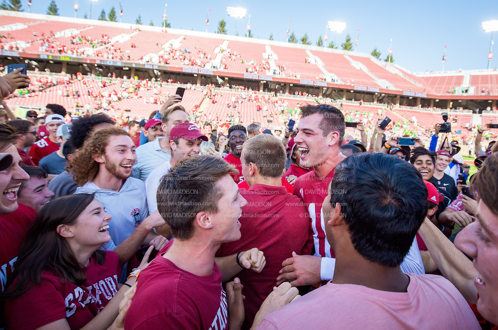 PALO ALTO, CA - OCTOBER 2:  Quarterback Tanner McKee #18 of the Stanford Cardinal celebrates on the field after  Stanford's 31-24 overtime victory over the Oregon Ducks in a Pac-12 college football game on October 2, 2021 at Stanford Stadium in Palo Alto, California.  (Photo by David Madison/Getty Images)