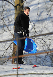 © Licensed to London News Pictures. 26 January 2013. Chipping Norton. Prime Minister David Cameron sledging in Chipping Norton today. Photo credit : MarkHemsworth/LNP
