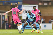 Hartlepool United Midfielder, Lewis Hawkins (18) Wycombe Wanderers Forward, Adebayo Akinfenwa (20) and Hartlepool United Defender, Aristote Nsiala (22) during the EFL Sky Bet League 2 match between Wycombe Wanderers and Hartlepool United at Adams Park, High Wycombe, England on 26 November 2016. Photo by Adam Rivers.