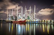 Photograph of shrimp boats at night