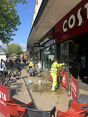 couple hit by shop front