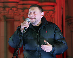 "© Licensed to London News Pictures . 03/02/2015 . Manchester , UK . Madchester star SHAUN RYDER , speaks to the crowd , at the demonstration . Demonstration organised by the Labour Party on the steps of Manchester City Council in Albert Sqaure , Manchester , under the banner ""manVcam"" ( Manchester vs Cameron ) . Organisers say Manchester - along with Liverpool and Birmingham - have suffered larger cuts than other regional authorities , whilst southern regions such as Surrey , Hampshire and West Sussex have all seen increases in government funding . Photo credit : Joel Goodman/LNP"