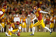 Nov 18, 2011; Ames, IA, USA; Iowa State Cyclones kicker Zach Guyer (25) kicks for extra points during a game against the Oklahoma State Cowboys at Jack Trice Stadium. Iowa State Cyclones defeated the Oklahoma State Cowboys 37-31. Mandatory Credit: Beth Hall-US PRESSWIRE Editorial sports photography of the Iowa State Cyclones vs. Oklahoma State Cowboys in 2011 in Aimes, Iowa.