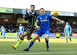 Liam Sercombe of Bristol Rovers challenges Barry Fuller of AFC Wimbledon - Mandatory by-line: Robbie Stephenson/JMP - 17/02/2018 - FOOTBALL - Cherry Red Records Stadium - Kingston upon Thames, England - AFC Wimbledon v Bristol Rovers - Sky Bet League One