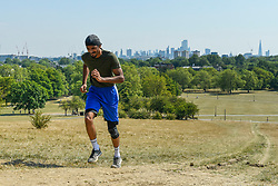 © Licensed to London News Pictures. 11/08/2020. LONDON, UK. Parvas Chow, a 19 year old student, practices a set of hill sprints up Primrose Hill in temperatures of 34C.  The forecast is for the heatwave to continue before thunderstorms arrive towards the end of the week.  Photo credit: Stephen Chung/LNP