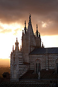 Sunset over the facade of the Duomo, Siena, Tuscany, Italy.
