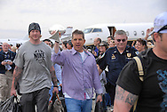 Photograph of New Orleans Saints Coach Sean Payton bringing home the Lombardi Trophy after the Saints beat the Colts in the 2010 Super Bowl.