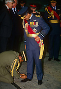 An officer attends to tying the shoelace of the Sultan of Brunei during a state visit to the UK in November 1992 at RAF Cranwell, England. Wearing the uniform of an RAF Air Chief Marshal, Hassanal Bolkiah, GCB GCMG full name: Sultan Haji Hassanal Bolkiah Muizzaddin Waddaulah ibni Al-Marhum Sultan Haji Omar Ali Saifuddien Saadul Khairi Waddien; b1946 is the 29th and current Sultan and Yang Di-Pertuan of Brunei. The eldest son of Sir Muda Omar Ali Saifuddien III and Raja Isteri Pengiran Anak Queen Damit, he succeeded to the throne as the Sultan of Brunei, following the abdication of his father on 4 October 1967. The Sultan has been ranked among the wealthiest individuals in the world; Forbes estimated the Sultans total peak net worth at US$20 billion in 2008.
