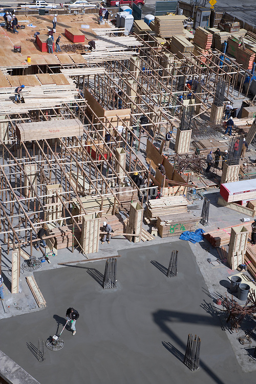 the various stages of building floors at a large under construction building site