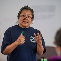 Gloria Begay, founding director of Dine Food Sovereignty Alliance speaks at the Healthy Kids Symposium at Navajo Technical University, Wednesday, July 18.