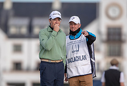 Actor Kyle McLachlan discusses his options with his caddy before he plays his second shot from the thick rough after slicing his tee shot at the 17th hole during day two of the Alfred Dunhill Links Championship at Carnoustie Golf Links, Angus.