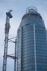 © licensed to London News Pictures. London, UK 16/01/2013. It is thought the helicopter involved in the crash in Vauxhall hit a crane of a new tower block in Vauxhall, London. Photo credit: Tolga Akmen/LNP