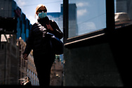 A woman walks near Flinders Street Station during COVID-19 in Melbourne, Australia. Premier Daniel Andrews announced today that some minor changes will be made to the current Stage 4 Restrictions in Melbourne. As yet, there is no sign of any meaningful change despite numbers of new cases being under 5 for the 14 day rolling average. Zero cases and no deaths were recorded in the past 24 hours in Victoria. (Photo by Dave Hewison/Speed Media)