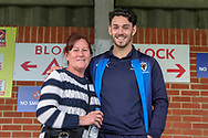 AFC Wimbledon defender Will Nightingale (5) with fan during the EFL Sky Bet League 1 match between AFC Wimbledon and Gillingham at the Cherry Red Records Stadium, Kingston, England on 23 March 2019.