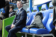 New Reading manager Nigel Adkins sits in the dugout before the match.  Barclays Premier league, Reading v Southampton at the Madejski stadium in Reading on Saturday 6th April 2013. pic by Andrew Orchard, Andrew Orchard sports photography,