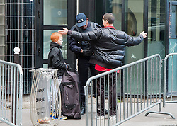 © Licensed to London News Pictures. 08/01/2016. Paris, France.. Armed police search two people entering Goutte D'Or police station in Northern Paris where police shot a man dead who threatened officers with a knife yesterday afternoon, January 7th. Photo credit: Hugo Michiels/LNP