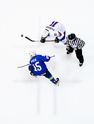 Iceland's Silvia Bjorgvinsdottir and Slovenia's Pia Pren (bottom) battle for the puck during the Beijing 2022 Olympics Women's Pre-Qualification Round Two Group F match at the Motorpoint Arena, Nottingham.