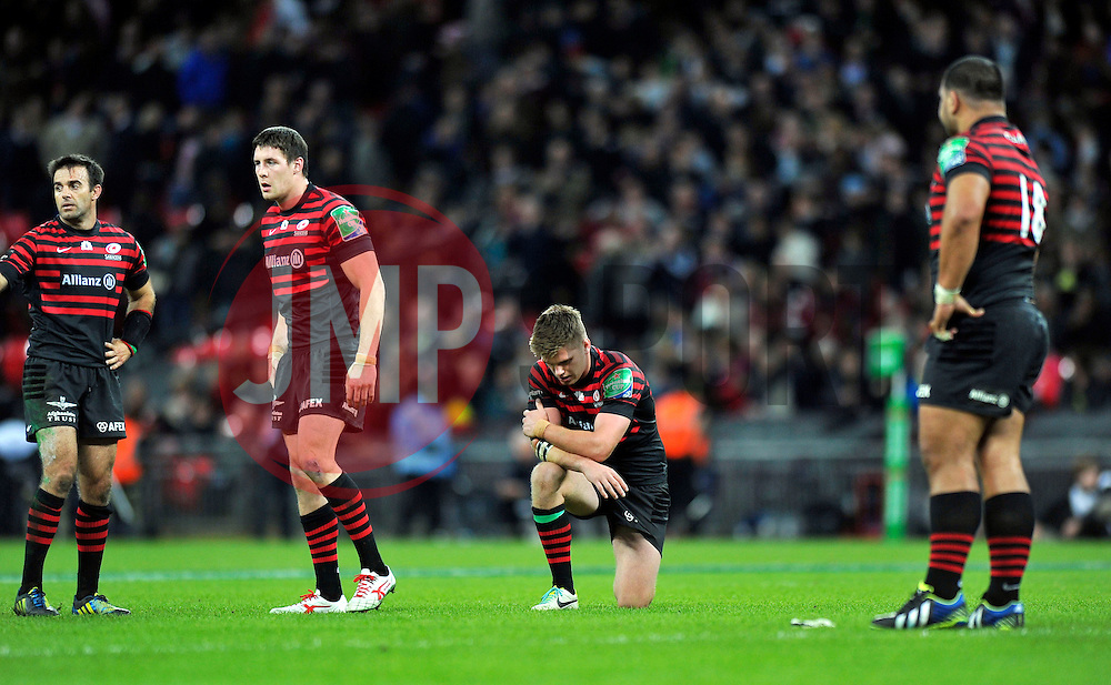 Saracens fly half Owen Farrell looks dejected after missing a late drop goal opportunity to win the game - Photo mandatory by-line: Patrick Khachfe/JMP - Tel: 07966 386802 - 18/10/2013 - SPORT - RUGBY UNION - Wembley Stadium, London - Saracens v Toulouse - Heineken Cup Round 2.