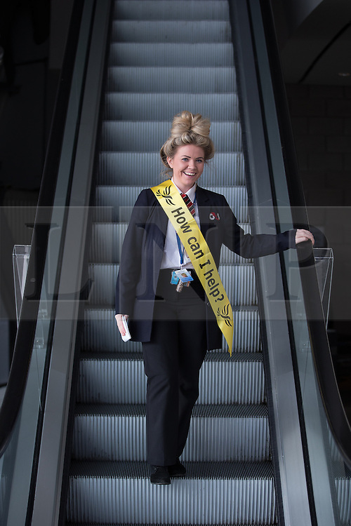 """© Licensed to London News Pictures . 04/10/2014 . Glasgow , UK . A woman wearing a yellow Liberal Democrat sash with """" How can I help? """" written across it . The Liberal Democrat Party Conference 2014 at the Scottish Exhibition and Conference Centre in Glasgow . Photo credit : Joel Goodman/LNP"""