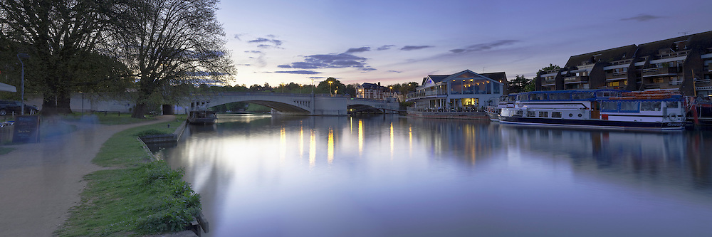 Caversham Bridge and Pipers Island on the River Thames in Reading, Berkshire at sunset