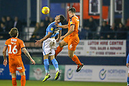 Luton Town defender Matthew Pearson (6) in the air with Bradford City forward Kai Brunker (18)  during the EFL Sky Bet League 1 match between Luton Town and Bradford City at Kenilworth Road, Luton, England on 27 November 2018.