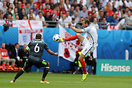 Harry Kane of England ® takes on Ashley Williams of Wales. UEFA Euro 2016, group B , England v Wales at Stade Bollaert -Delelis  in Lens, France on Thursday 16th June 2016, pic by  Andrew Orchard, Andrew Orchard sports photography.