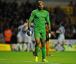 Wolverhampton Wanderers' Carl Ikeme cuts a dejected figure as his side go 0 - 2 down as Huddersfield Town's Sean Scannell celebrates his goal in the background - Photo mandatory by-line: Dougie Allward/JMP - Mobile: 07966 386802 - 01/10/2014 - SPORT - Football - Wolverhampton - Molineux Stadium - Wolverhampton Wonderers v Huddersfield Town - Sky Bet Championship
