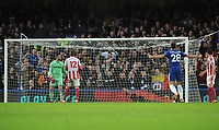 Football - 2017 / 2018 Premier League - Chelsea vs. Stoke City<br /> <br /> Danny Drinkwater of Chelsea floats the ball into the far corner of the net for goal no 2 past Jack Butland, at Stamford Bridge.<br /> <br /> COLORSPORT/ANDREW COWIE