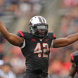 Oct 6, 2012: Rutgers Scarlet Knights linebacker Steve Beauharnais (42) waves four fingers to the crowd at the start of the fourth quarter during second half NCAA college football action between the Rutgers Scarlet Knights and UConn Huskies at High Point Solutions Stadium in Piscataway, N.J.