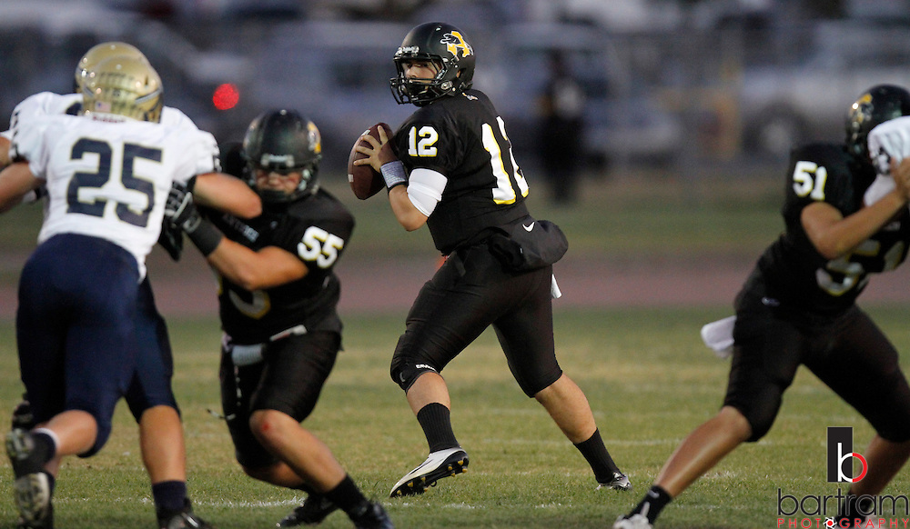 Antioch High School quarterback Troy Amate looks for a receiver during the first quarter against Napa High School on Friday, Sept. 23, 2011. (Photo by Kevin Bartram)