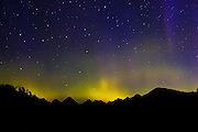 A severe solar storm resulted in this vibrant display of the northern lights (aurora borealis) over several Vancouver Island peaks. Mountains in this image include Mount Walker, Malaspina Peak, Mount Alava, Stevens Peak, Leighton Peak and Conuma Peak.