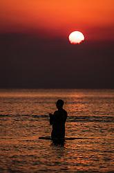 THEMENBILD - Silhouette eines Touristen im Mittelmeer bei Sonnenaufgang an einem heissen Sommertag, aufgenommen am 17. August 2018 in Larnaka, Zypern // Silhouette of a tourist in the Mediterranean at sunrise on a hot summer Day, Larnaca, Cyprus on 2018/08/17. EXPA Pictures © 2018, PhotoCredit: EXPA/ JFK
