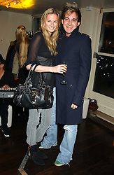 EUGENIE WARRE and RICHARD DENNEN at the launch of a new bar Bardo, 101-105 Walton Street, London SW3 on 29th November 2005.<br /><br />NON EXCLUSIVE - WORLD RIGHTS