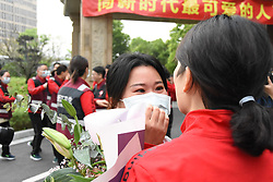 ZHEJIANG, April 18, 2020  Medical workers say goodbye to each other after a 14-day quarantine in Anji, east China's Zhejiang Province, April 18, 2020. The last batch of medical workers from Zhejiang Province, who aided the fight against COVID-19 in Hubei Province, finished their 14-day quarantine. (Photo by Cui Li/Xinhua) (Credit Image: © Cui Li/Xinhua via ZUMA Wire)