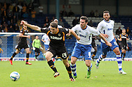 Newport County's Conor Washington tries to get the better of Bury's Tommy Miller. Skybet Football League two match, Bury v Newport county at Gigg Lane in Bury on Saturday 5th Oct 2013. pic by David Richards, Andrew Orchard sports photography,