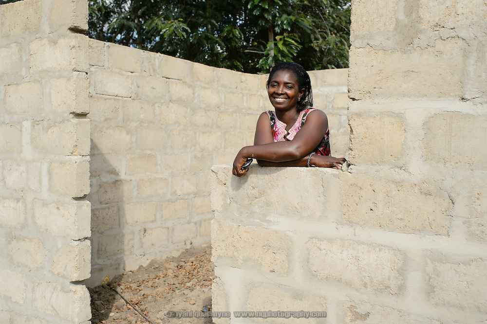 Patience Diaba, a 'Banking on Change' Village Savings and Loan Association (VSLA) member, at Dabala Junction in the Volta Region of Ghana on 12 September 2012. Diaba is using her savings to construct a storage room to expand her smoked fish business.