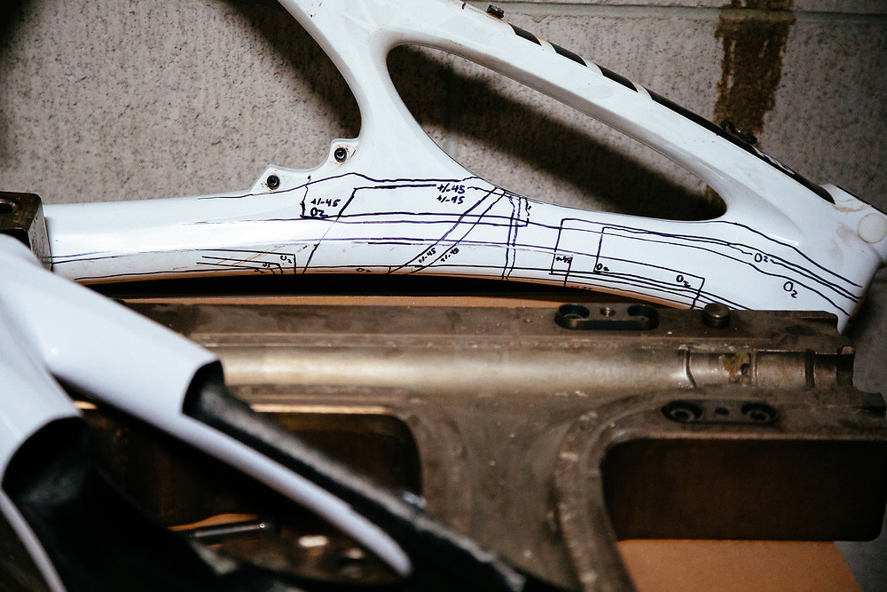 A carbon frame cut-away and diagram of what forces react on a frame.