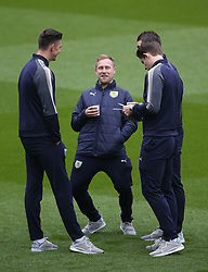 Burnley's Scott Arfield shares a joke with team mates before the game against Leicester City