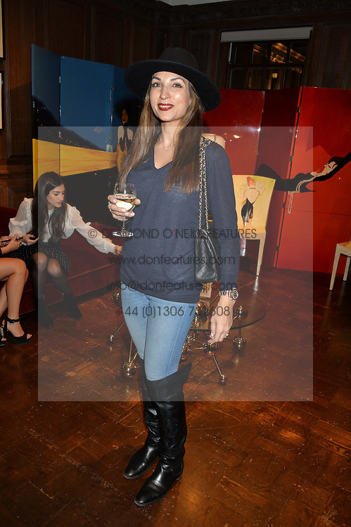 ***UK_MAGAZINES_OUT***<br /> LONDON, ENGLAND 30 NOVEMBER 2016: <br /> Left to right, Tooba Ghafur at the launch of In The Spirit of Gstaad at Maison Assouline, Piccadilly, London hosted by Mandolyna Theodoracopulos and Homera Sahni England. 30 November 2016.