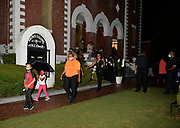 7/25/2020 Selma Alabama Mourners pay their respect  at the Historic Brown A.M.E. Chapel Church after a private ceremony their was a public viewing with an open casket for the last time. Congressman and Civil Rights icon John Lewis's casket is seen being carried out of historic  Brown Chapel A.M.E. Church at the end of the last public viewing with the casket open before he is brought across the Edmund Pettus Bridge for the last time on his way to lay in state at the Alabama. State Capitol on Sunday.. Photo© Suzi Altman