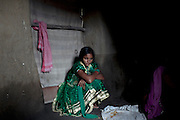 (name changed) Kanchan Kumari Sharma, 12, is sitting insider her home in Sersiya Kekrahi village, Varanasi District, Uttar Pradesh, India. In 2012, Kanchan went with a friend to bring lunch to her father, around 2 km away from her home. On the way they met Rajesh (rapist) and Ashok, a friend of his. Both girls were picked up on the spot using an excuse. Ashok drove Kanchan's friend home, but Rajesh forced Kanchan to travel with him during six days and for hundreds of kilometres across different states. (Mirzapur / Chennai / Itarsi / Bhusawal) He raped her once behind the station in Itarsi. With great effort and some coincidence, the uncle of Kanchan managed to bring her back home. Although she was scared, she insisted on going to the police to file a case (FIR). She was kept at the police station for 12 days and threatened to prevent her from filing an official case. Ashok and Rajesh are from higher caste and wealthy families. While Rajesh spent 24 days in jail initially in summer 2012, he is now a free man while the trial is still going on. Kanchan's family is now struggling to put together 30.000 Indian Rupees (500 USD) to continue battling for justice in court.
