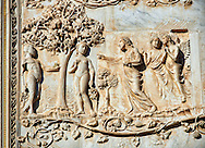 Bas-relief sculpture panel scene of Eve and Adam 's fall being discovered by Maitani around 1310 on the14th century Tuscan Gothic style facade of the Cathedral of Orvieto, Umbria, Italy .<br /> <br /> Visit our ITALY HISTORIC PLACES PHOTO COLLECTION for more   photos of Italy to download or buy as prints https://funkystock.photoshelter.com/gallery-collection/2b-Pictures-Images-of-Italy-Photos-of-Italian-Historic-Landmark-Sites/C0000qxA2zGFjd_k<br /> .<br /> <br /> Visit our MEDIEVAL PHOTO COLLECTIONS for more   photos  to download or buy as prints https://funkystock.photoshelter.com/gallery-collection/Medieval-Middle-Ages-Historic-Places-Arcaeological-Sites-Pictures-Images-of/C0000B5ZA54_WD0s