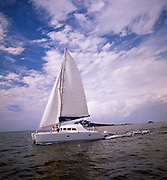 A sailboat coasts in the waters of the carribean