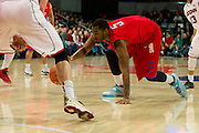 DALLAS, TX - JANUARY 4: Markus Kennedy #5 of the SMU Mustangs dives for a lose ball against the Connecticut Huskies on January 4, 2014 at Moody Coliseum in Dallas, Texas.  (Photo by Cooper Neill) *** Local Caption *** Markus Kennedy