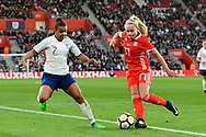 Charlotte Estcourt (17) of Wales is challenged by Nikita Parris (7) of England during the FIFA Women's World Cup UEFA Qualifier match between England Ladies and Wales Women at the St Mary's Stadium, Southampton, England on 6 April 2018. Picture by Graham Hunt.